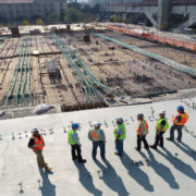 Construction workers surveying a site